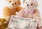 お金とクマ